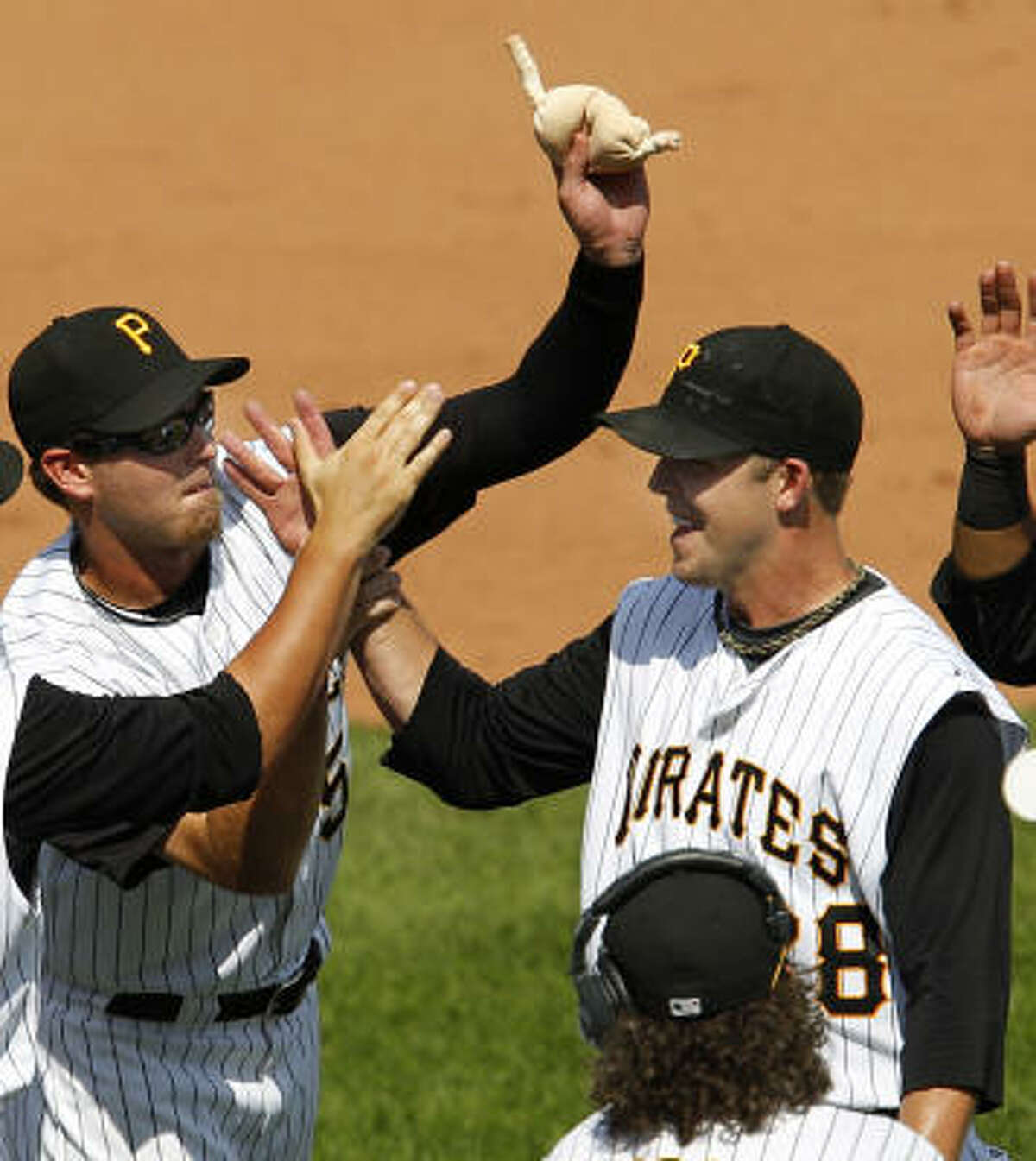 Paul Maholm, right, is congratulated by teammate Zach Duke, left, after finishing his three-hitter.