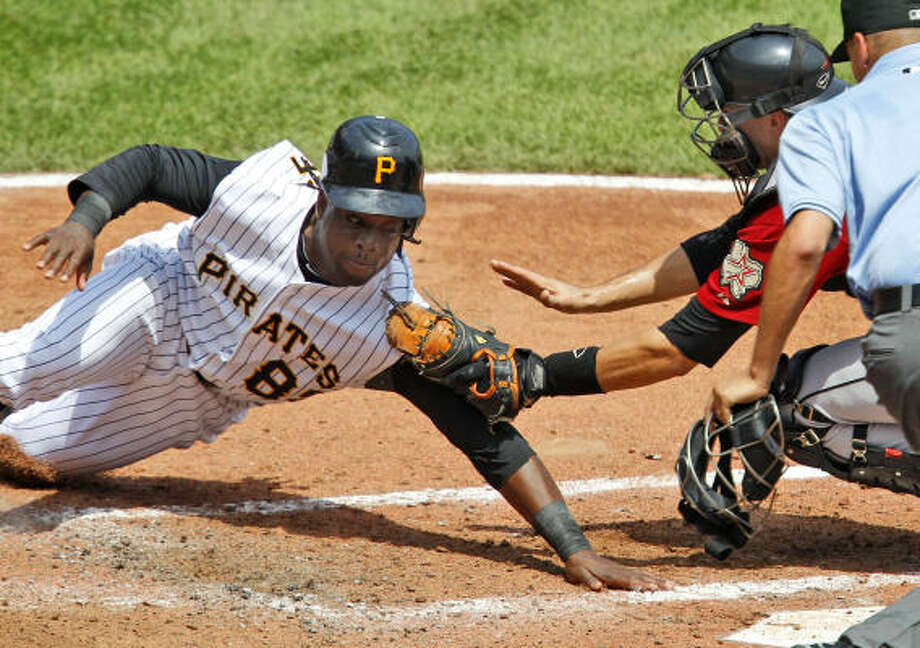 Astros catcher Jason Castro tags out Lastings Milledge, who was trying to score on a single. Photo: Gene J. Puskar, AP