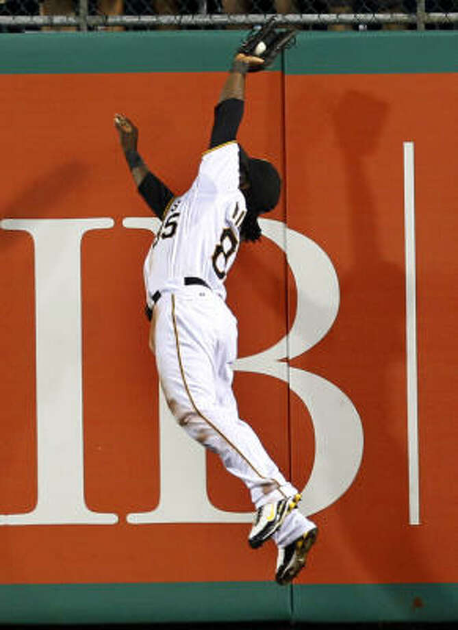 Pirates right fielder Lastings Milledge makes a leaping catch on a fly ball by Michael Bourn to end the sixth inning. Photo: Gene J. Puskar, AP