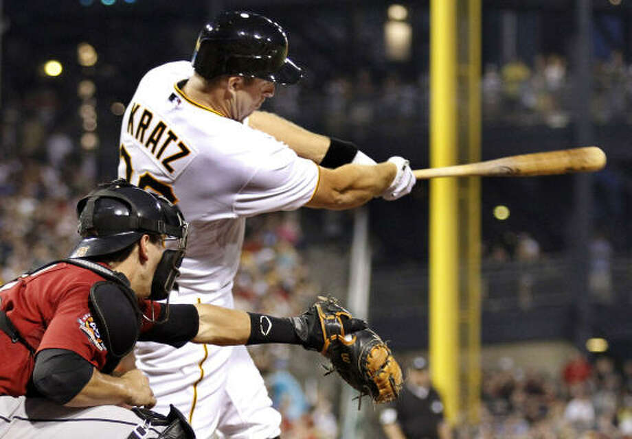 Pittsburgh's Erik Kratz drove in Garrett Jones for the game's final run with a single in the eighth inning. Photo: Gene J. Puskar, AP