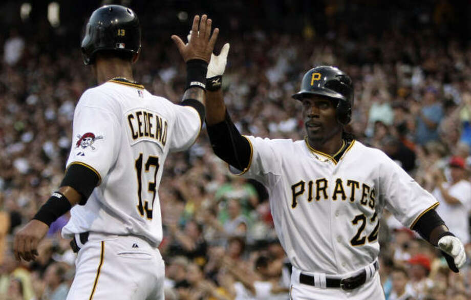 Pittsburgh's Ronnie Cedeno, left, and Andrew McCutchen score on a second-inning double by Jose Tabata. Photo: Gene J. Puskar, AP