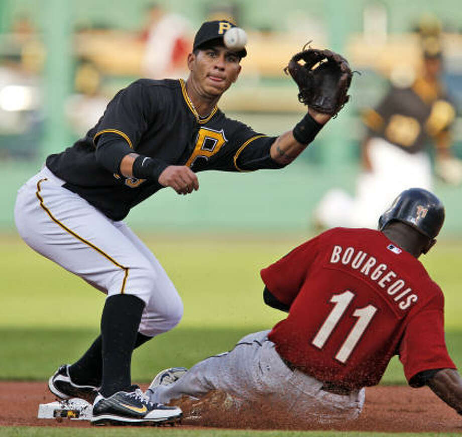 Pirates shortstop Ronnie Cedeno, left, takes the late throw from catcher Ryan Doumit as Astros left fielder Jason Bourgeois steals second in the first inning. Photo: Gene J. Puskar, AP