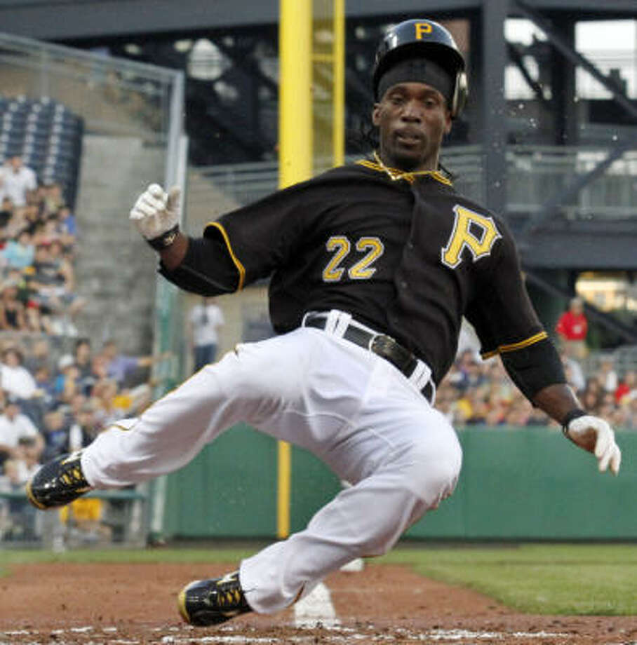 Pirates center fielder Andrew McCutchen scores from third on a sacrifice fly by Pirates second fielder Neil Walker in the fourth inning. Photo: Gene J. Puskar, AP