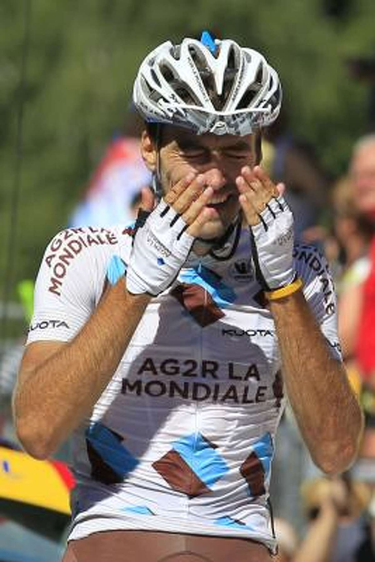 Christophe Riblon of France crosses the finish line to win the 14th stage.
