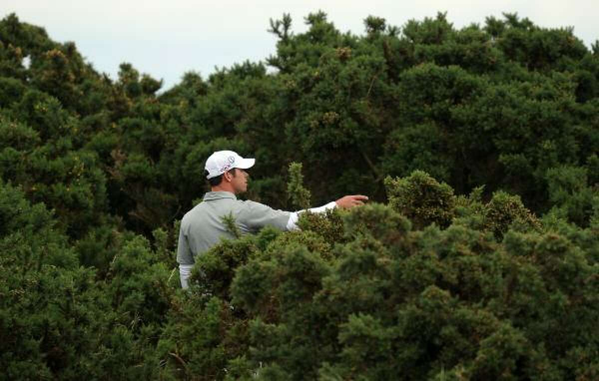 Paul Casey fell out of contention when he found the bushes on the 12th hole and triple-bogeyed.