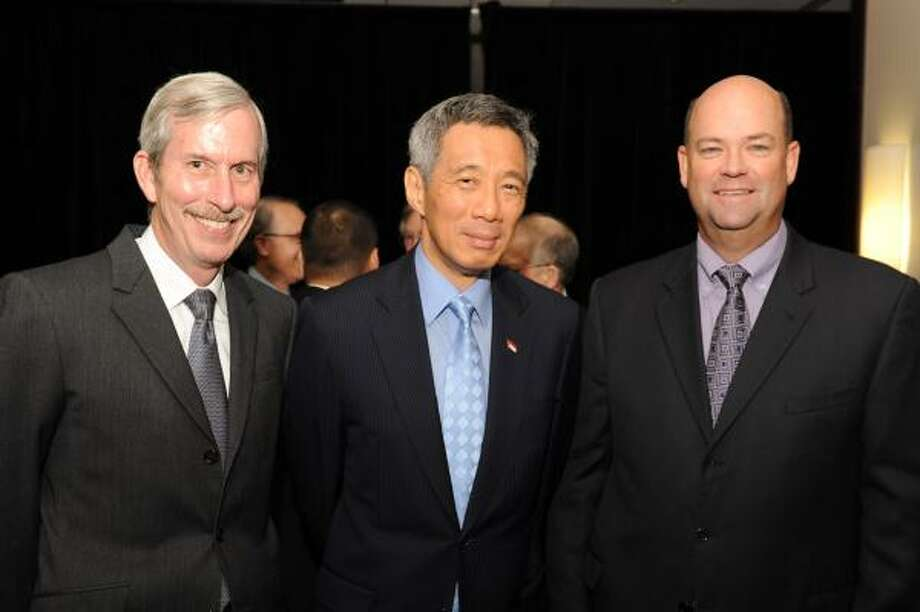 John Carrig, Singapore Prime Minister Lee Hsien Loong and Ryan Lance at a luncheon hosted by Asia Society Texas Center and the Greater Houston Partnership. Photo: Courtesy Photo
