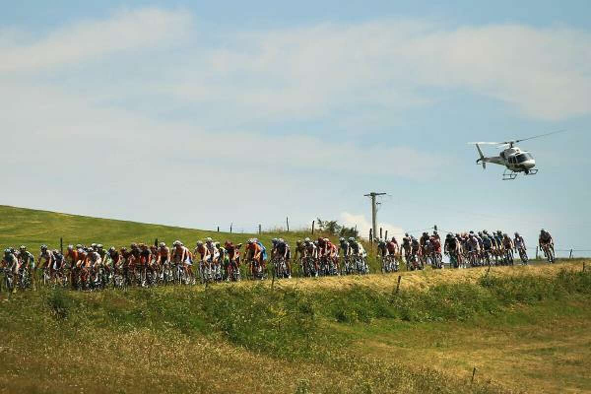 The peloton travels through a rural French landscape along stage 12 of the Tour de France.
