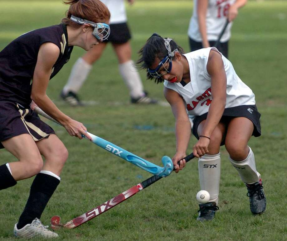 Masuk's #3 Simone Romano, right, tries to corral the ball as Barlow's #2 Hope Ianiri converges, during game action in Monroe, Conn. on Tuesday Oct. 06, 2009. Photo: Christian Abraham / Connecticut Post