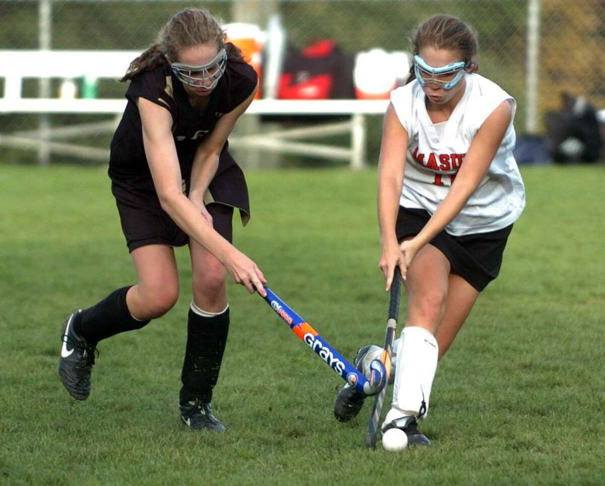 Masuk's #18 Natalie Ciancetta, right, tries to block an advance by Barlow's #16 Anne Dolan, during game action in Monroe, Conn. on Tuesday Oct. 06, 2009.