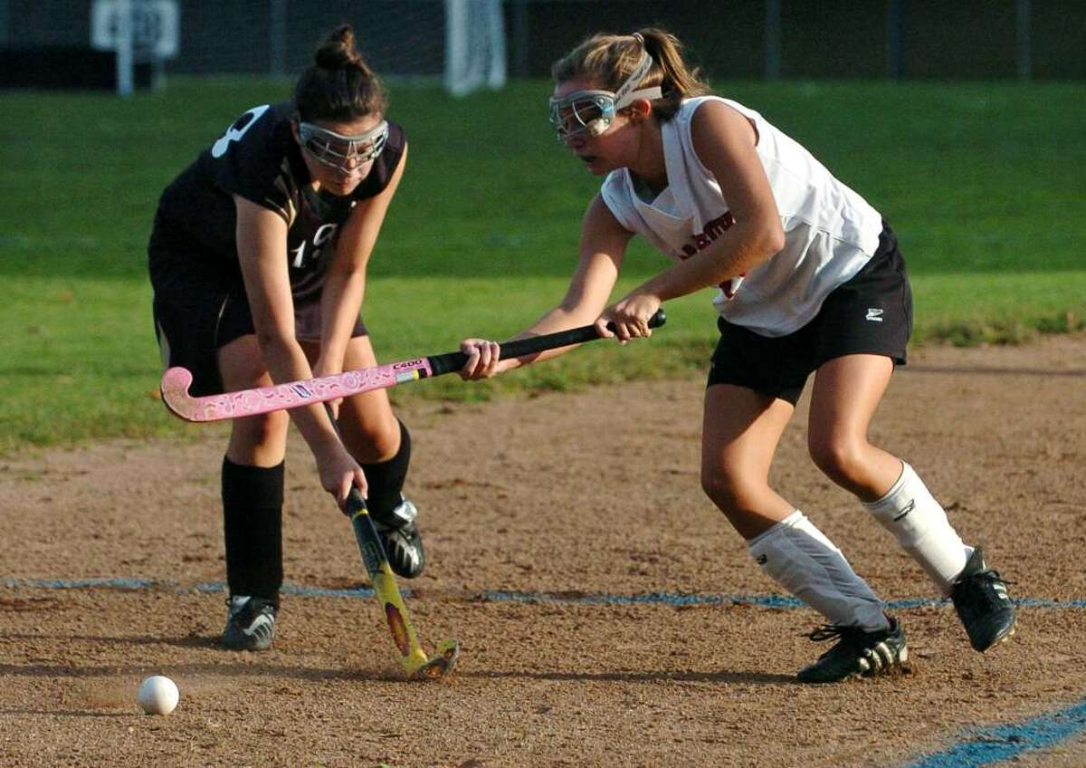 Masuk's #26 Carly Paul, right, tries to head off Barlow's #19 Margaret O'Leary, during game action in Monroe, Conn. on Tuesday Oct. 06, 2009.
