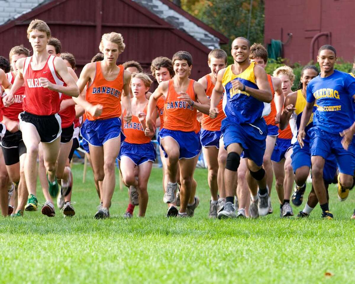 The boys cross country race gets underway at Tarrywile Park in Danbury Tuesday.