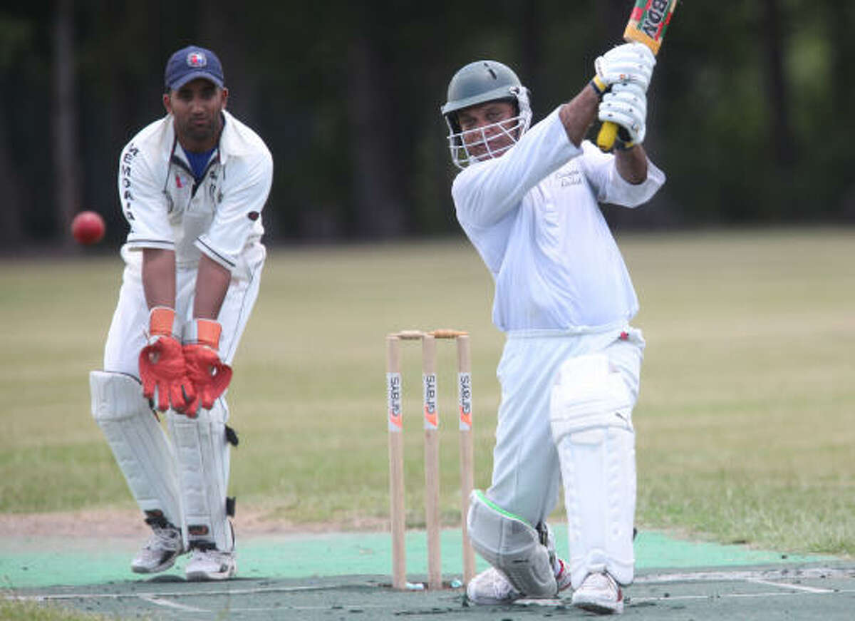 Jam Niaz, right, a member of the Houston Cougars Cricket Club, hits the ball as he plays against the Memorial Nationals Cricket Club.