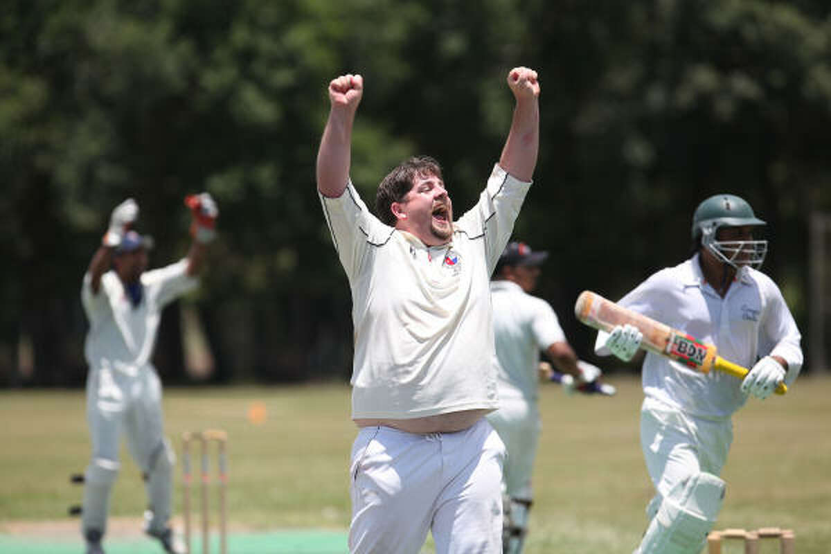 Sean Chapman, center, bowler (pitcher) for the Memorial Nationals Cricket Club, celebrates getting Jam Niaz, a member of the Houston Cougars Cricket Club, out of the game at Stafford Park. Niaz is the player that has scored the most centuries without getting out in the Houston Cricket League.