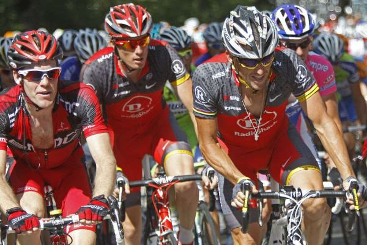 Lance Armstrong, right, climbs with the pack.