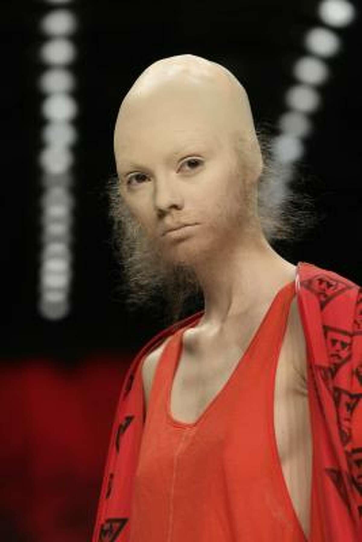 Patrick Mohr's Spring/Summer 2011 collection was worn by models with skullcaps and glued-on fuzzy facial hair.
