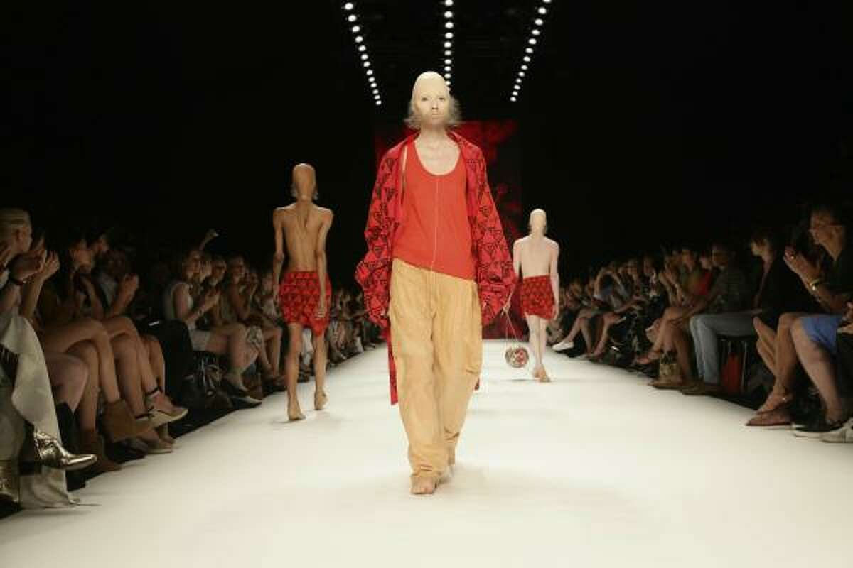 The beards are one way the German designer plays with androgyny.