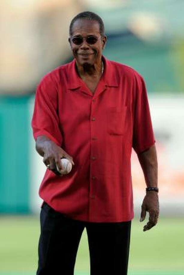Baseball Hall of Fame member Rod Carew throws out the first pitch. Photo: Pool, Getty Images