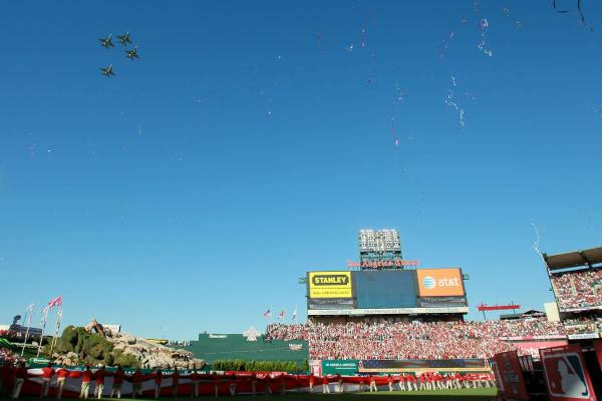 Jets fly over Angel Stadium before the start of the game.