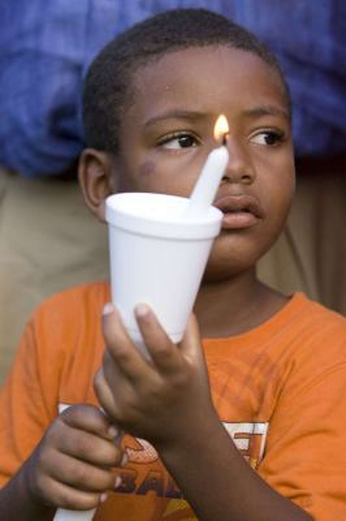 Five year-old Christiansen Abney during a prayer vigil to honor the memory of 6-year-old Tekerrious Jackson. Well wishers visited the site of the small apartment complex in Houston where Tekerrious Jackson was allegedly beaten to death by his father.