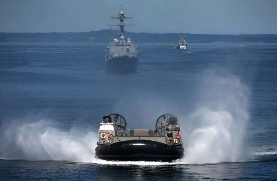 A Landing Craft Air Cushion (LCAC) is launched from the rear of the USS Bonhomme Richard during the Seafair Parade of Ships on Wednesday, August 3, 2011 on Puget Sound and along the Seattle waterfront. Photo: JOSHUA TRUJILLO / SEATTLEPI.COM