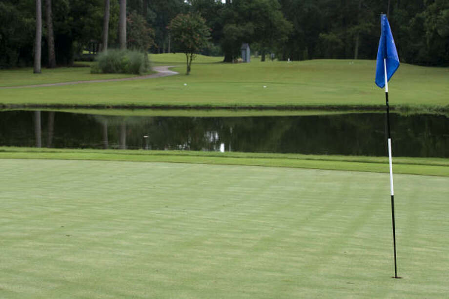 "Kingwood Country Club (Marsh Course), Hole 8  Yardage: 127 yards  No. of Aces: 12  Description: The large green sits directly behind a large pond. But the toughest element here is a green that slopes severely from back to front. Depending on where the pin is, it can be a very friendly or menacing hole.  What the pro says: ""The hole is very easy to hit. It has a large green for a very short hole. It generally plays downwind. It is a fun hole to play. The green is so large, you don't expect that on a short hole. It is very playable.'' -- Wayne Higgins, assistant pro. Photo: Yasmeen Smalley, Chronicle"