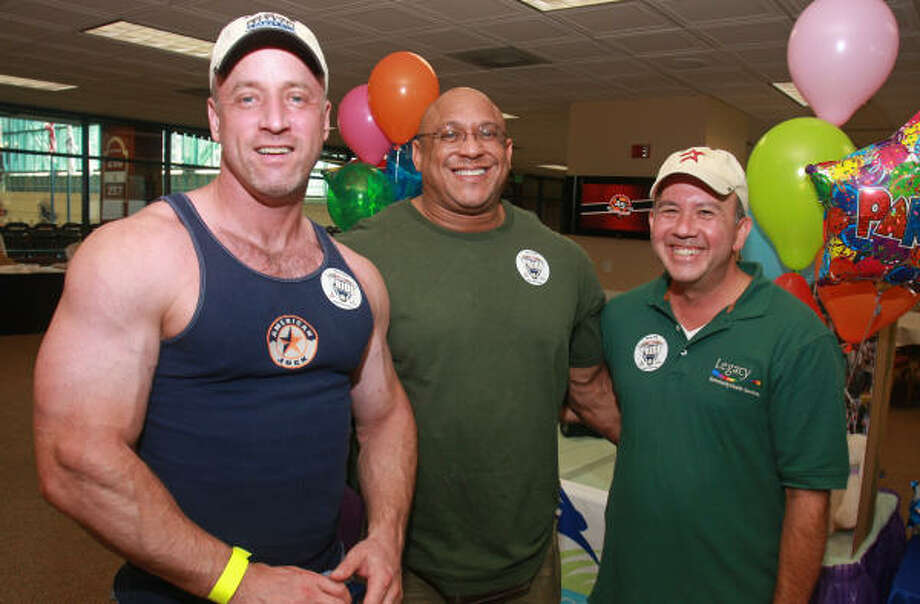 Jack Cole, from left, Jaymes Alexander and Timmy Martinez at the VIP reception for Pride in the Park, an LGBT event at Minute Maid Park. Photo: Gary Fountain, For The Chronicle