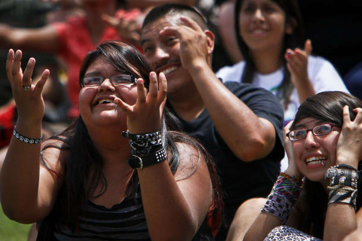 Itzel Almazan, 15, left, Guillermo Zaiate and Stephanie Diaz, 15, react to a goal attempt during a World Cup Soccer watch party at Discovery Green Sunday.
