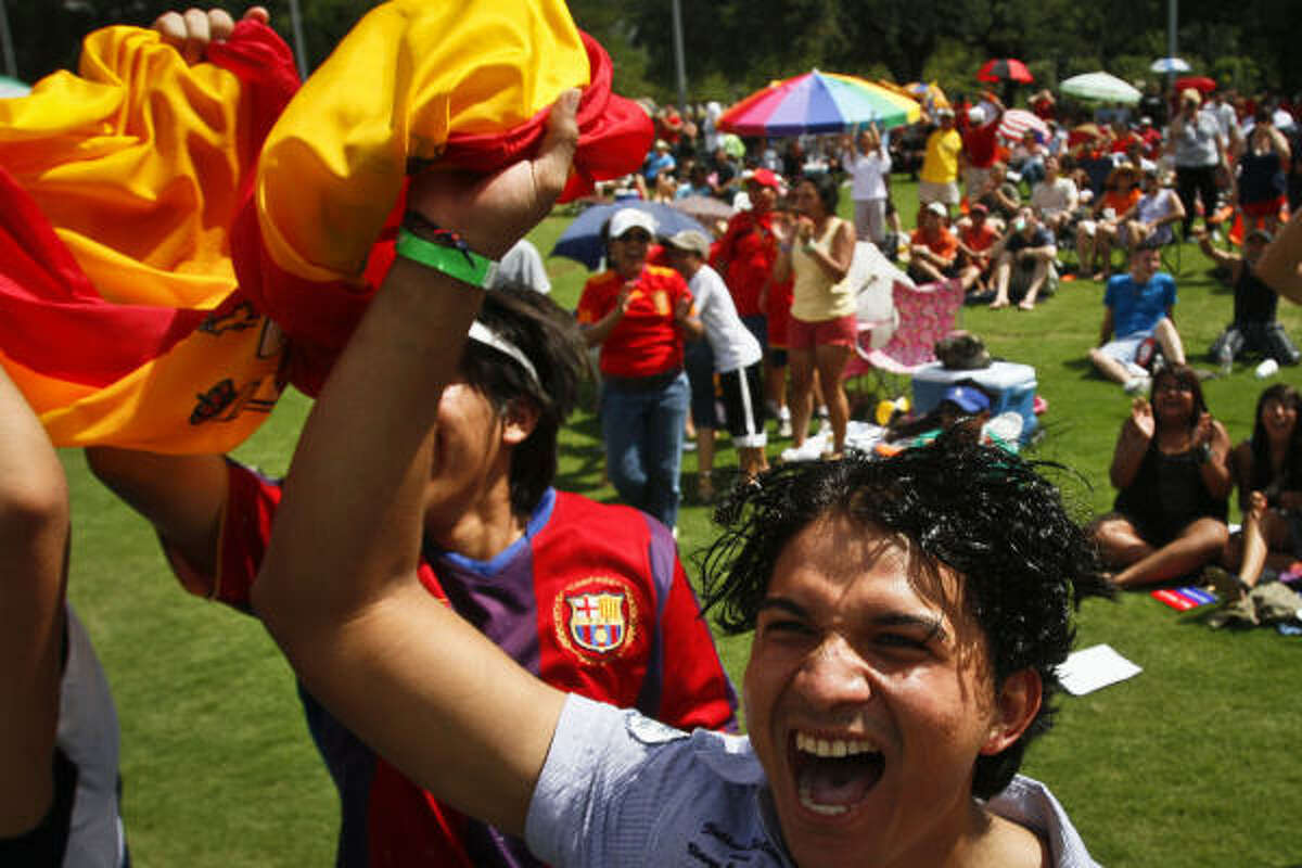 Franko Suazo and other soccer fans react to a goal made by Andres Iniesta in the 116th minute during a World Cup Soccer watch party at Discovery Green Sunday.