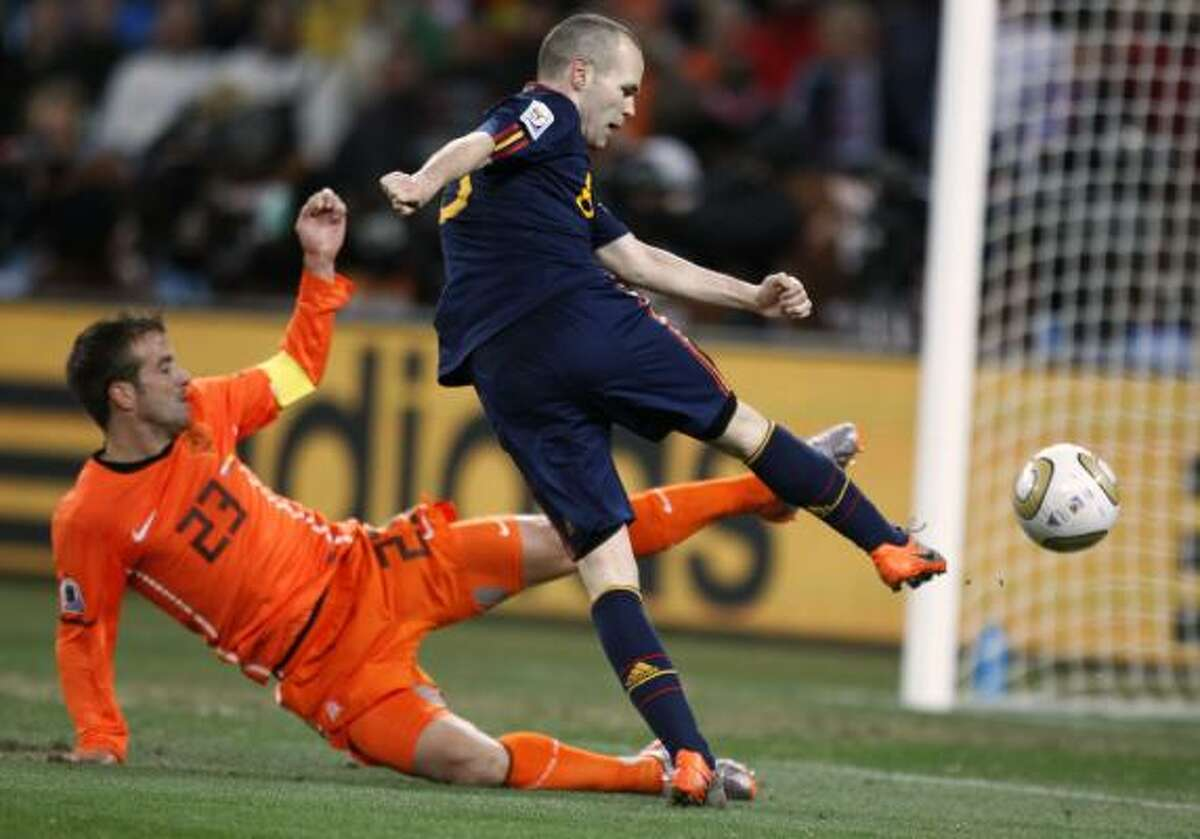 Spain 1, Netherlands 0 Spain's Andres Iniesta scores the winning goal in the 116th minute.