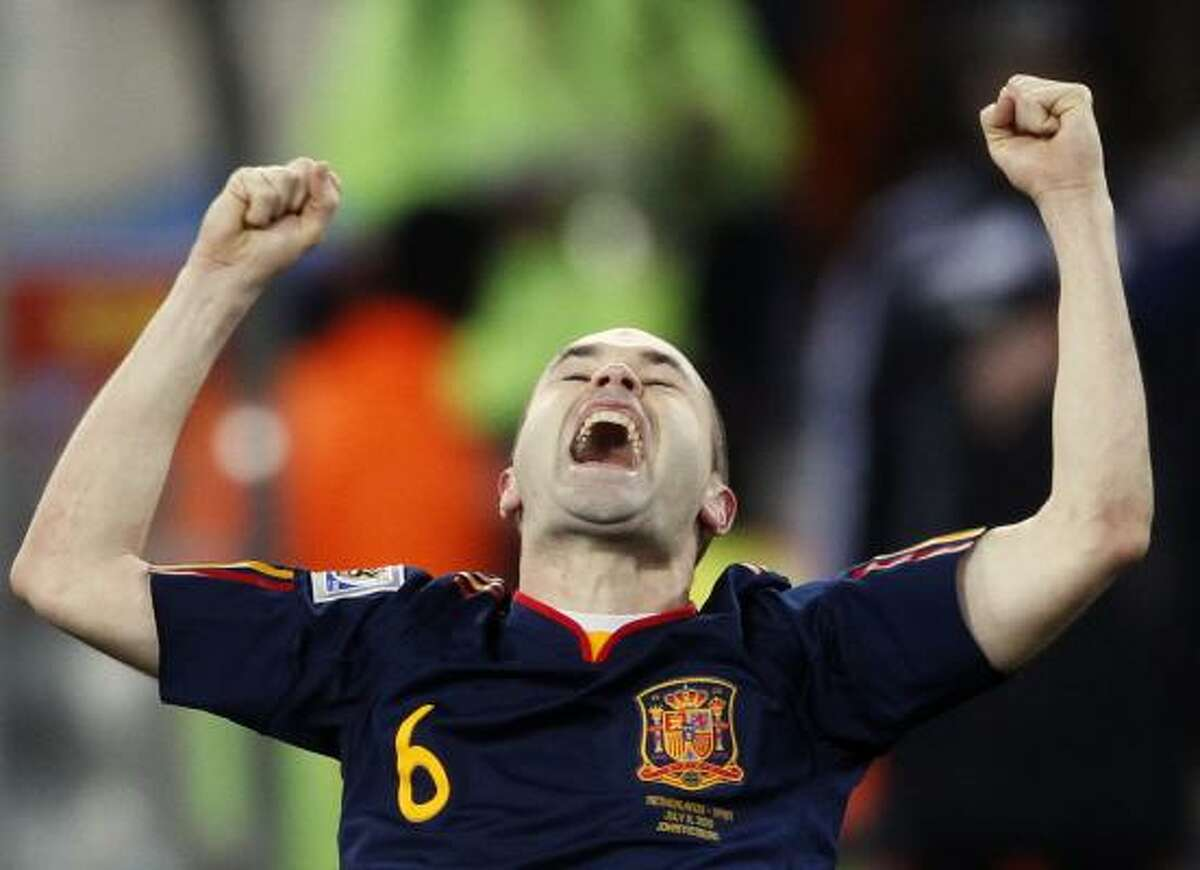 Spain's Andres Iniesta celebrates after scoring the winning goal.
