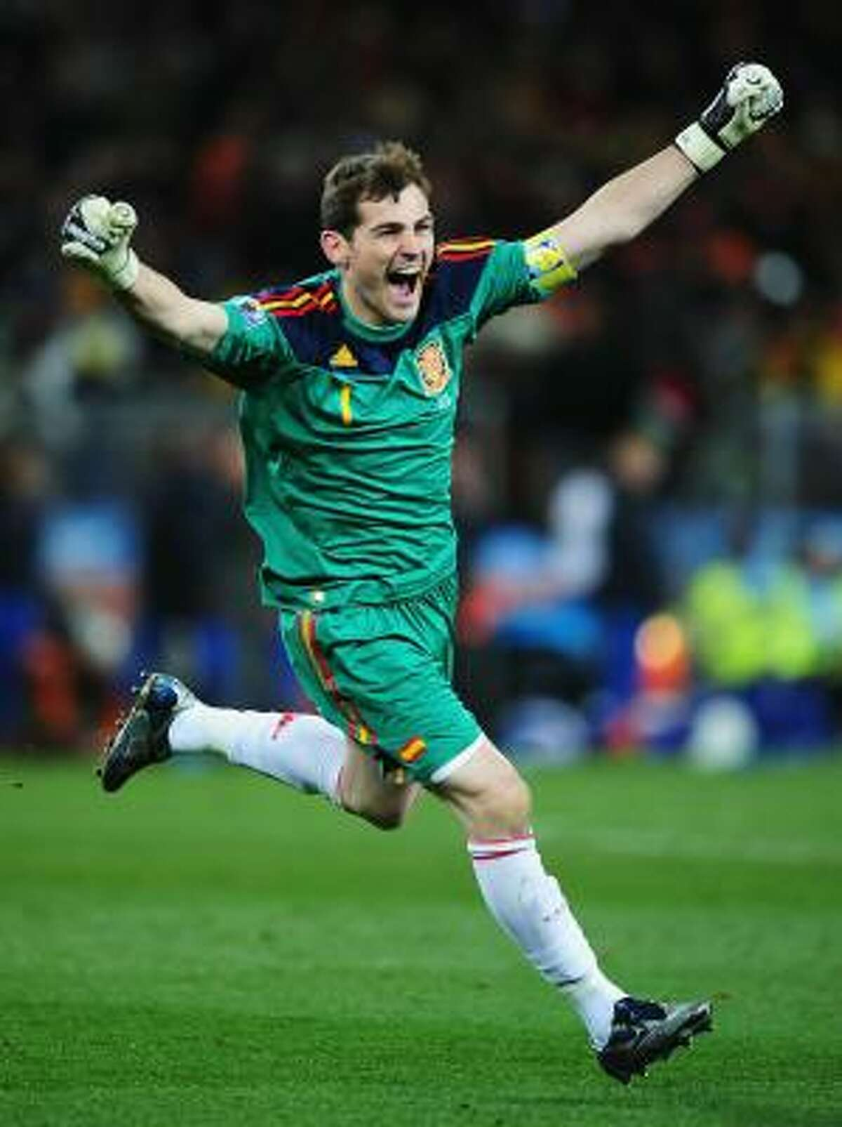Iker Casillas, Spain's captain, celebrates the late goal by Andres Iniesta.