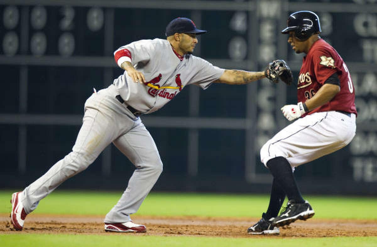 Cardinals 4, Astros 2 Cardinals third baseman Felipe Lopez reaches to tag out Astros shortstop Angel Sanchez.
