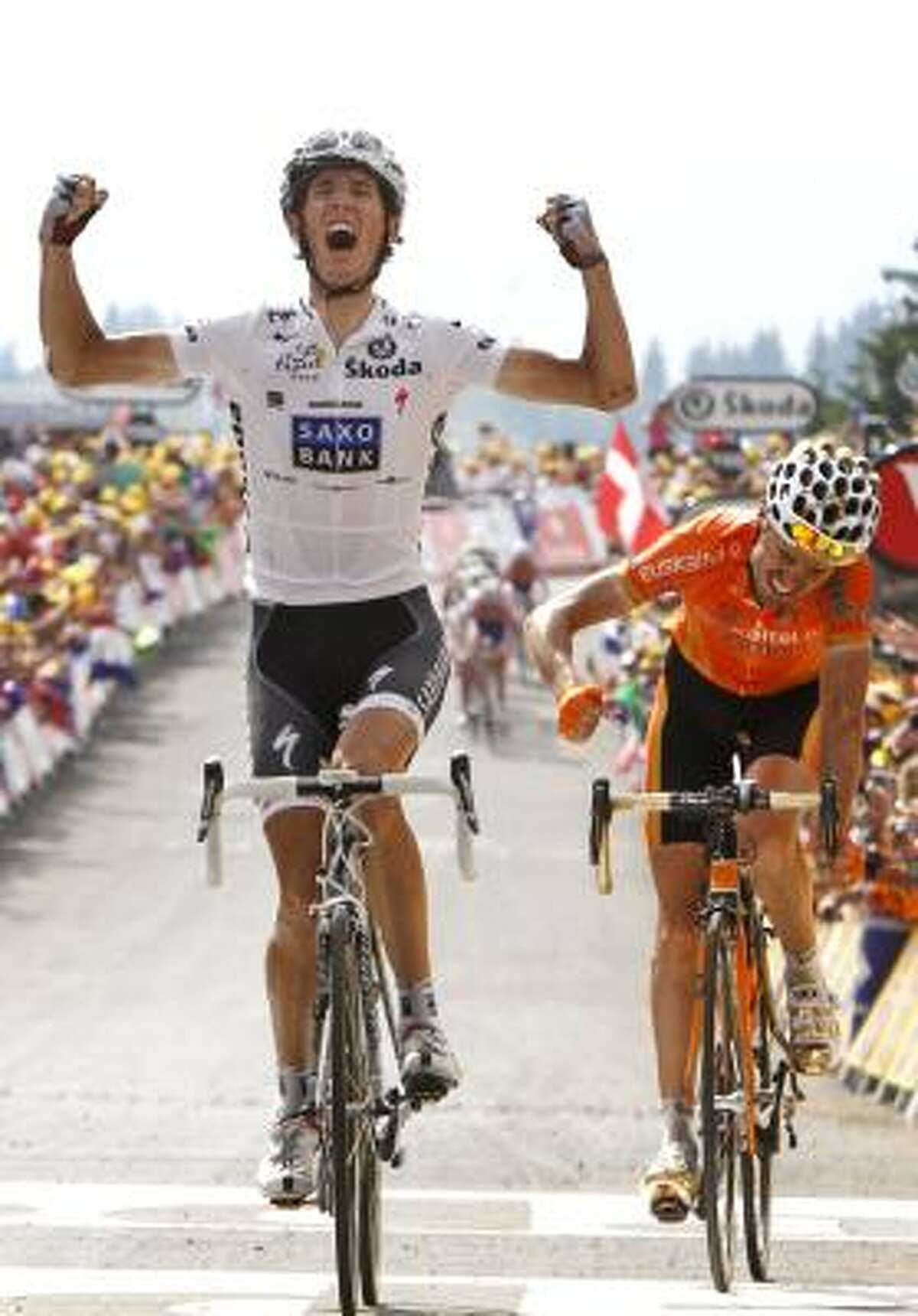 Andy Schleck crosses the finish line to win the eighth stage.