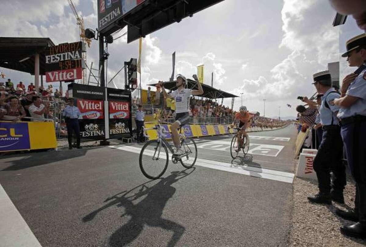 Andy Schleck crosses the finish line in Morzine-Avoriaz, France.
