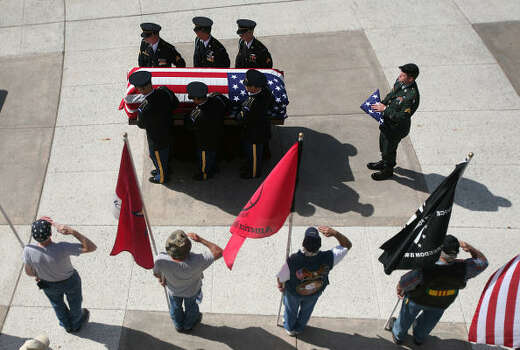 Remains of U.S. Army Spc. Matthew Catlett are carried into the memorial service at Houston National Cemetery in Houston. Photo: Mayra Beltran, Chronicle