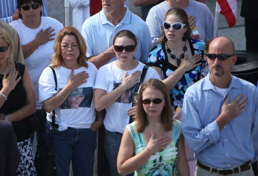 Family and friends attend the memorial service for U.S. Army Spc. Matthew Catlett at Houston National Cemetery in Houston. Photo: Mayra Beltran, Chronicle