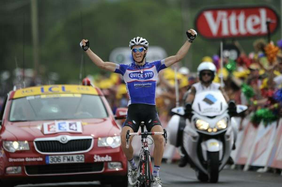 France's Sylvain Chavanel celebrates at the finish line as he wins the 165.5-kilometer seventh stage.