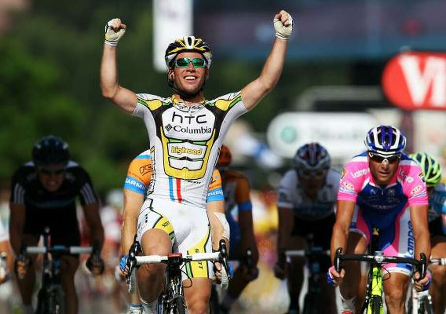Britain's Mark Cavendish of team HTC Columbia celebrates after winning stage 6 on Friday. It was Cavendish's second straight sprint-finish victory. Photo: Bryn Lennon, Getty Images