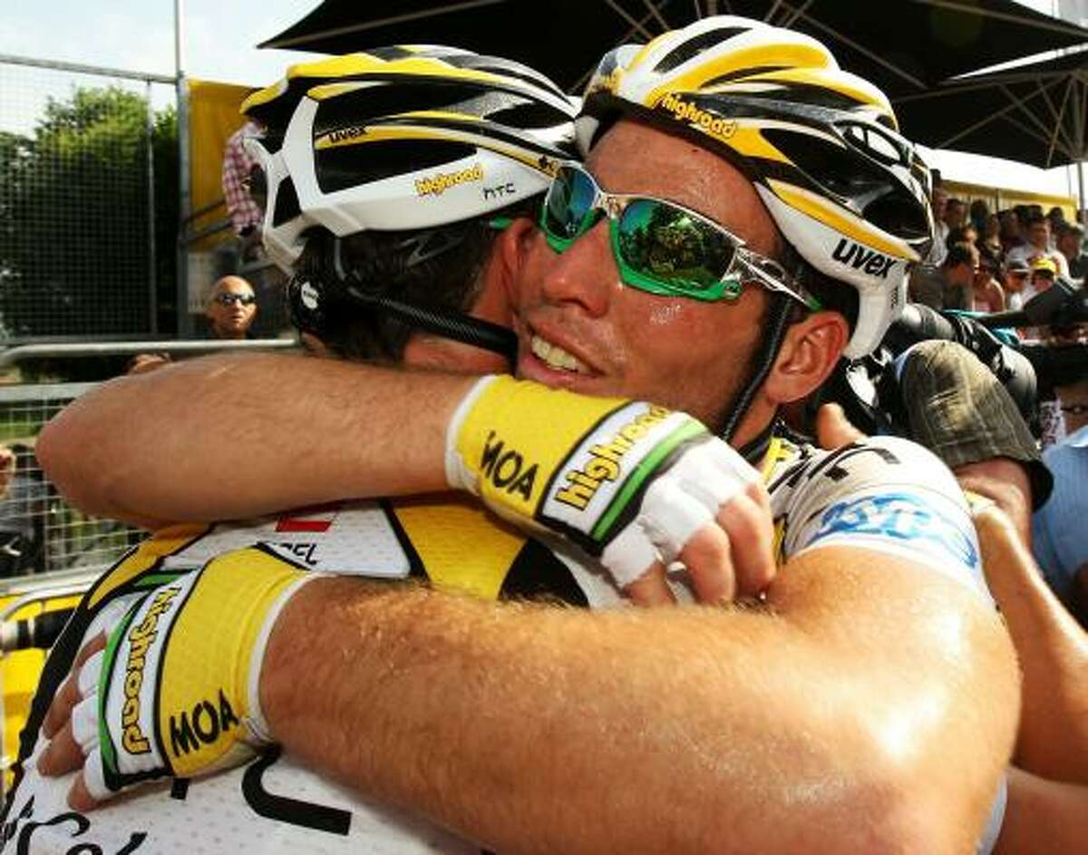Mark Cavendish is congratulated by HTC Columbia teammate Bernhard Eisel of Austria after winning Stage 6.