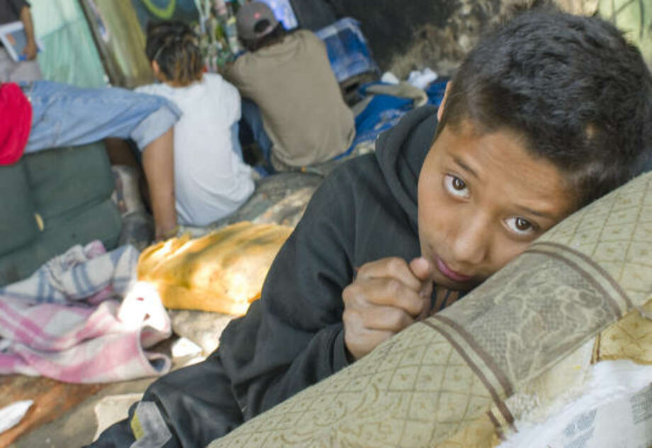 In the southern part of the city under an expressway overpass, a squalid camp is home to some 25 children, adolescents and young adults who have decided to make the streets their home.  Jonathan Raigosa, 15, is seen in the camp. Photo: Keith Dannemiller, For The Chronicle