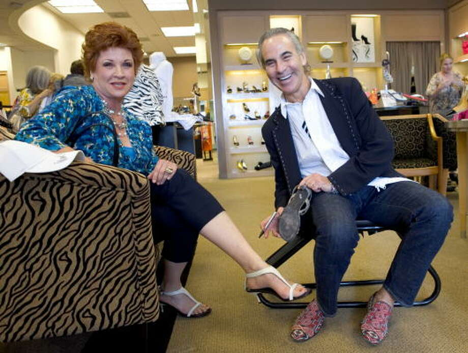 Sue Neumann has shoe designer Donald J Pliner sign one of her old Donald J Pliner shoes as she tries on a new pair during his appearance at Julian Gold. Photo: Jamie Couch Karutz