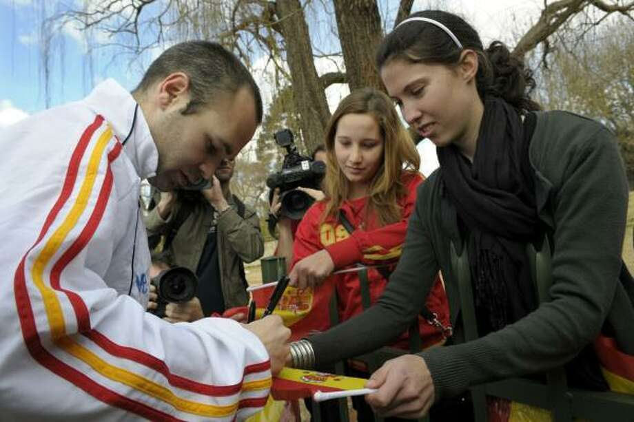 Spain midfielder Andres Iniesta signs autographs for fans at the North West University Sports Village in Potchefstroom, on July 9, two days before the final against the Netherlands. Photo: LLUIS GENE, AFP/Getty Images