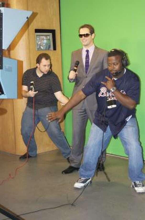 """Nick Kosir, center, is the """"Rapping Weatherman"""" at Channel 4 in Beaumont. He's joined by production assistants Kevin Foux, right, and John Jones. Photo: MIKE McNEILL"""