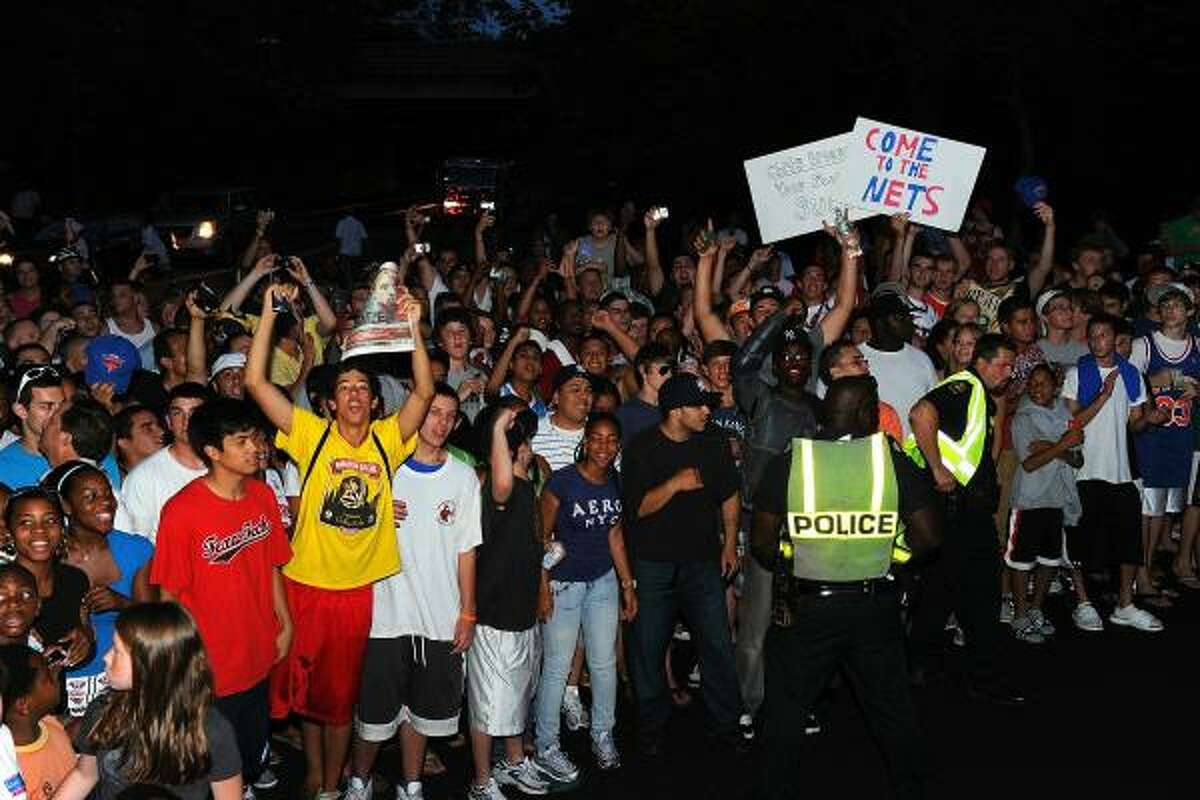 Fans gather outside the Boys & Girls Club of America in Greenwich, Conn., where LeBron James announced his future NBA plans.