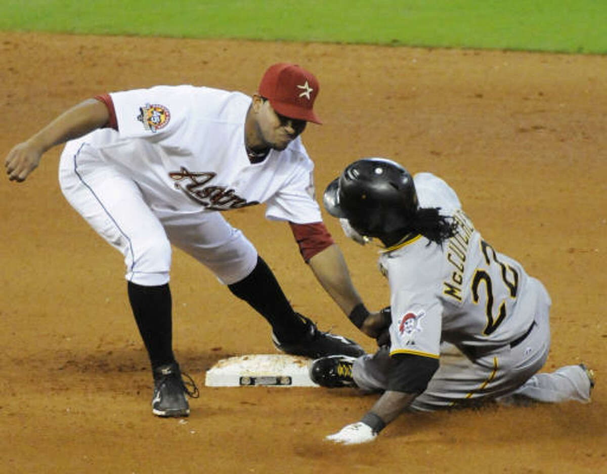 Astros shortstop Angel Sanchez, left, applies the tag to Pittsburgh's Andrew McCutchen on a steal attempt in the eighth inning. McCutchen was safe on the close play.