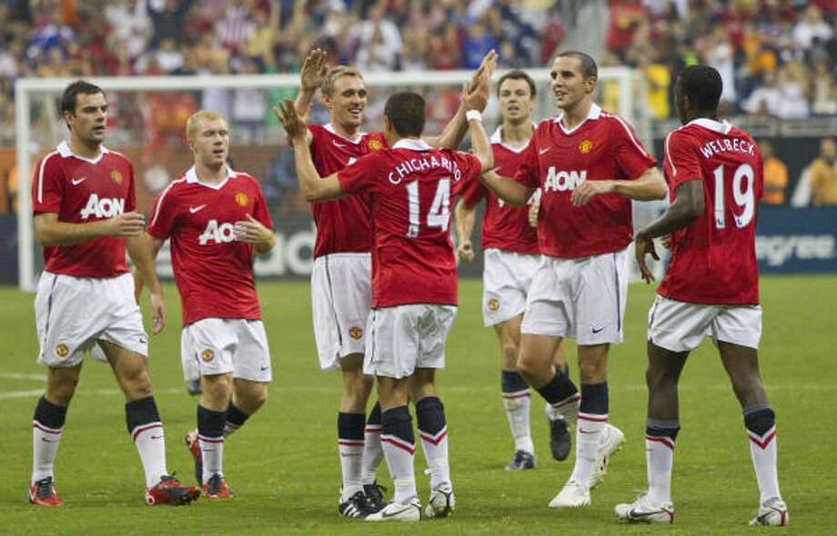 Manchester United players celebrate one of their five goals against the MLS All-Stars. Photo: Brett Coomer, Chronicle