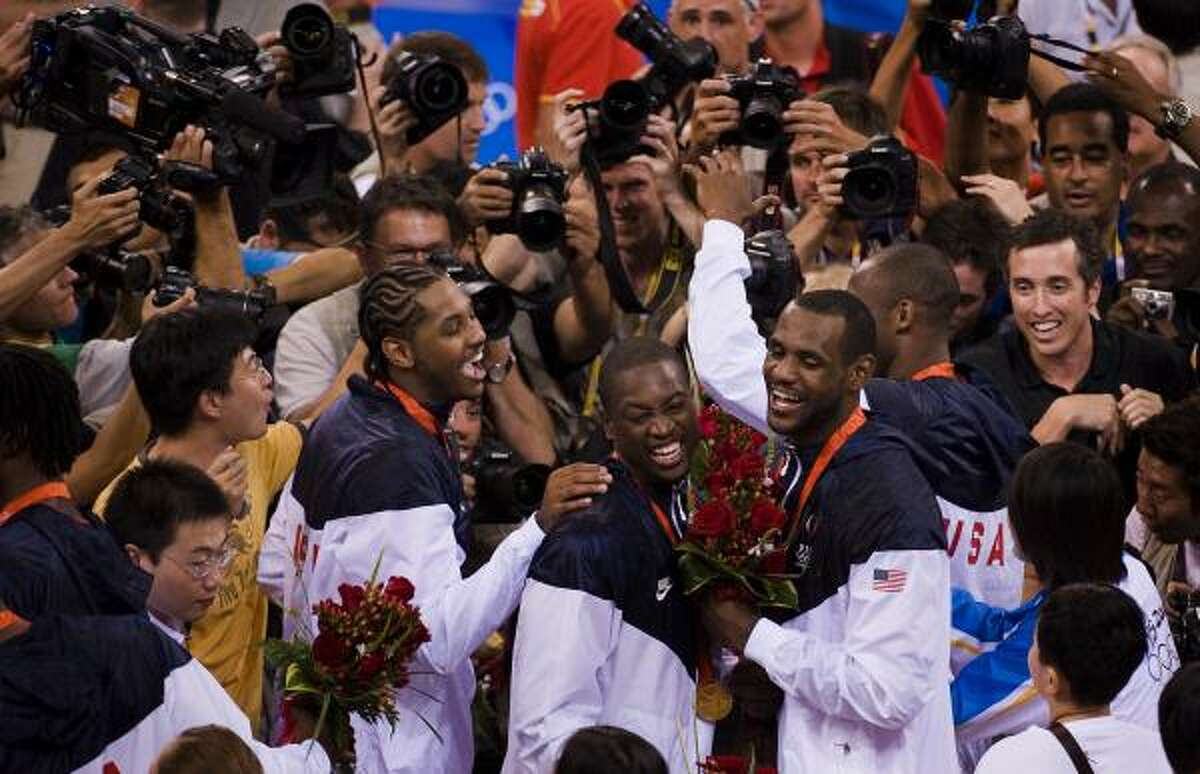 2008 LeBron James, right, teamed up with fellow NBA superstars Dwyane Wade, center, and Carmelo Anthony to lead the U.S. national team to the gold medal at the 2008 Summer Olympics in Beijing.