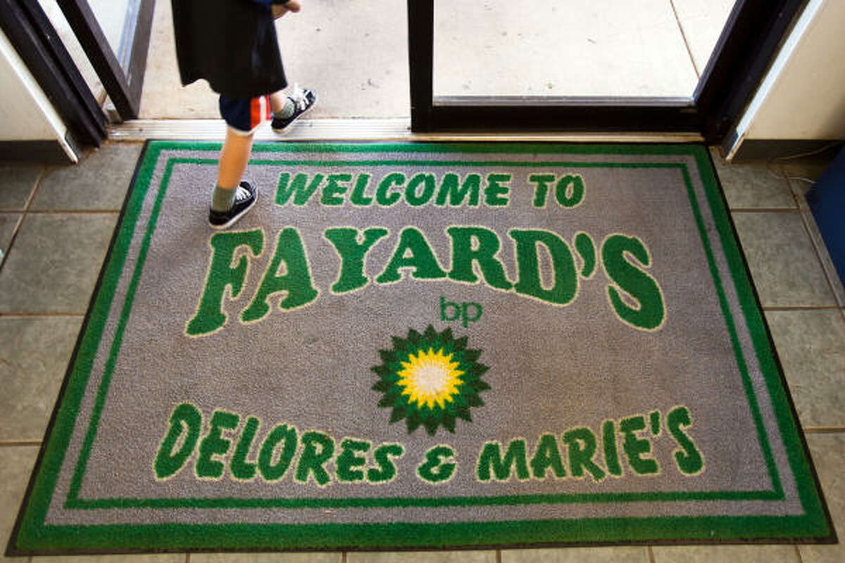 A customer walks over a welcome mat at Fayard's BP in Biloxi, MS.