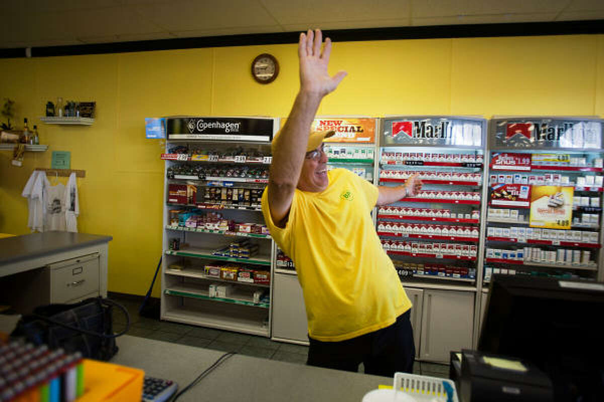 Wearing a signature yellow t-shirt bearing BP logo, Keith Fayard waves to a customer at his gas pumps as he works the registers at Fayard's BP station in Biloxi. Fayard says he is grateful for customers who have remained loyal to the station, convienence store and deli operations despite anger with the oil giant over the gulf spill.