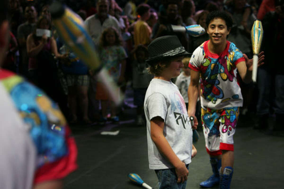 Drake Pinard, 8, is not fazed as he stands in between jugglers during the preview show on opening night.